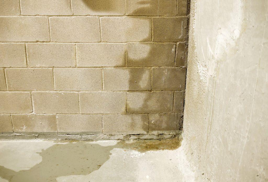 concrete basement wall leaking