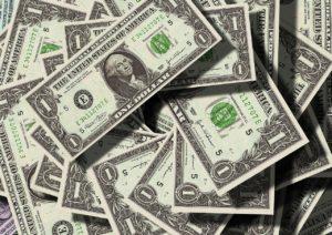 Pile of one dollar American bills.