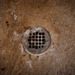 Sewer backup can be a stinky problem, one of the common basement smells you may encounter.